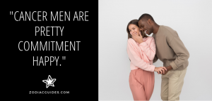 woman smiling and looking shy with a man smiling and whispering to her with a quote about Cancer men and commitment